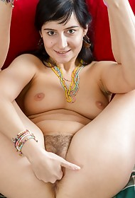 Alina smiles as she grabs firmly her bum cheeks, making her full bush visible even while wearing ...