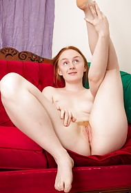 Canadian Addie undresses her slender body on the sofa of her bedroom, exposing her smooth pale sk...